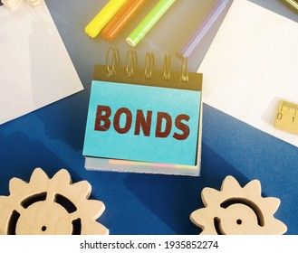 Notes with the word Bonds. A bond is a security that indicates that the investor has provided a loan to the issuer. Equivalent loan. Unsecured and secured bonds. - Shutterstock ID 1935852274