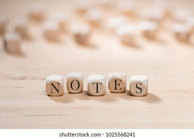 Notes word on wooden cubes. Notes concept