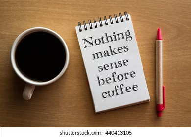 Nothing makes sense before coffee - handwriting on a notebook with cup of coffee