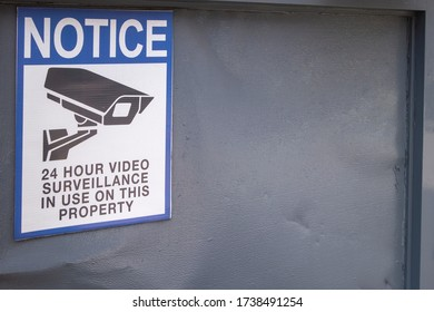 Notice of 24 hour video surveillance in use on this property with icon of video camera cctv