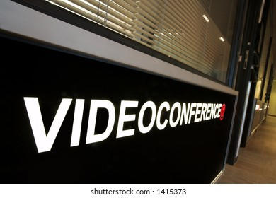 A notice against a wall of an office that reads:  Video Conference.