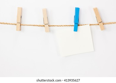 Notice card, white paper and wood clips on white background