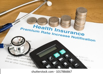 NOTICE OF INCREASING IN PREMIUM RATE OF HEALTH INSURANCE WITH STACKED COINS CALCULATOR AND A STETHOSCOPE (MEDICATION CONCEPT)