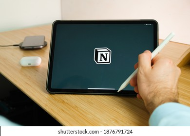 Notion is used with apple pencil on iPad Pro tablet . Man using application on the tablet. December 2020, San Francisco, USA.