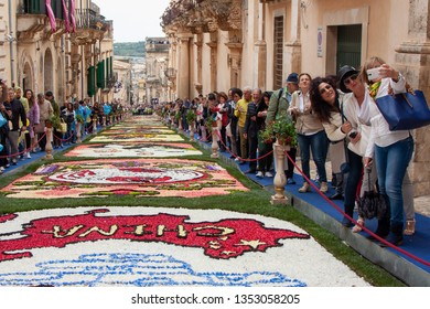 """NOTO, Ct/Italy - 05 20 2018: Flower Festival of Noto in Sicily. One of the most colourful festivals anywhere in the world takes place every year. Theme 2018: """"China in Bloom-The Silk Road""""."""