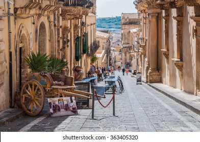 NOTO, ITALY - SEPTEMBER 14, 2015: Traditional Sicilian cart on street in old city centre of Noto, Sicily, Italy. UNESCO World Heritage Site.