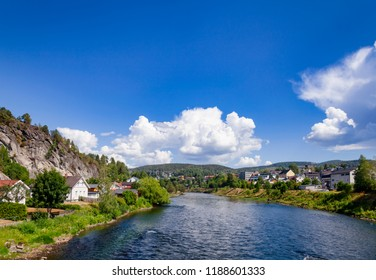 Notodden cityscape with Tinn river on a bright summer day. Notodden is a part of UNESCO Rjukan-Notodden Industrial Heritage Site. Telemark County, Norway