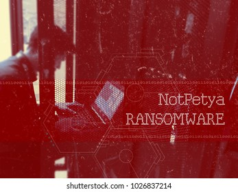 NotPetya Ransomware, Man using laptop to deploy a virus. Cybersecurity Concept