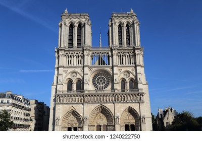 Notre Dame cathedral against a blue sky in Paris, France