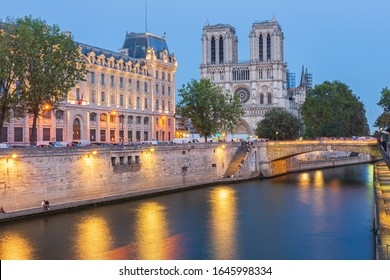 The Notre Dame Cathedral next to the Seine river in the city of Paris.