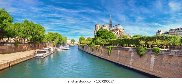"""Notre Dame Cathedral in Paris in Spring from the bridge called """"Pont de l'Archeveche"""", panoramic image"""
