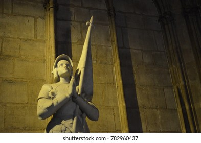 NOTRE DAME CATHEDRAL, PARIS/FRANCE - DECEMBER 2017: Statue of Saint Joana D'arc in Notre Dame Cathedral illuminated by a yellow light, Paris/France.