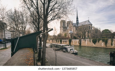 Notre Dame cathedral and Seine riverbanks in Paris, France