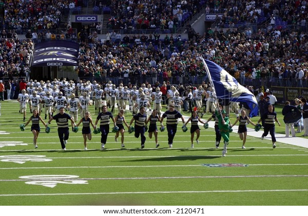 The Notre Dame Cheerleaders, Coaches, and Players take the field before the Navy game on October 28, 2006
