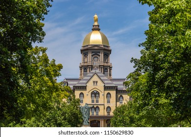 Notre Dame - Circa August 2018: Mary stands atop the Golden Dome of the University of Notre Dame Main Administration Building IV