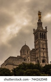 notre dame de la garde , marseille french , marsiglia francia , cathedral with big clouds and heavy clouds