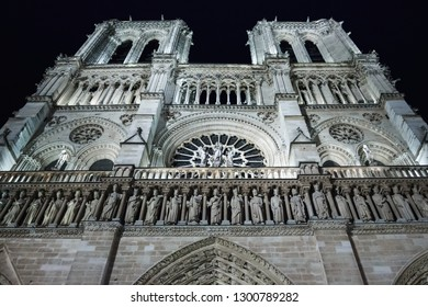 Notre Dame de Paris cathedral at night, view from square