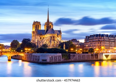 Notre Dame de Paris Cathedral and Seine River at night