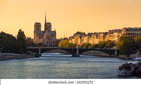 Notre Dame de Paris Cathedral, Ile Saint Louis, the Sully Bridge, and the Seine River at sunset in Summer. 4th Arrondissement of Paris. France