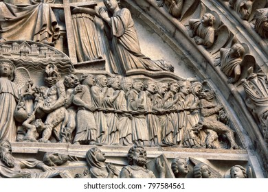 Notre Dame de Paris. Element arched portal, Lancet doorway Western portal, portal of last judgment, string of sinners and demons. Weighing sins in day of judgement, king of kings Christ Judge