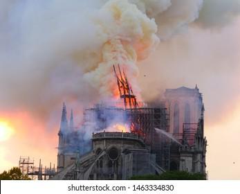 Notre dame de Paris in fire at the end of the day. Paris, France - APRIL 15, 2019
