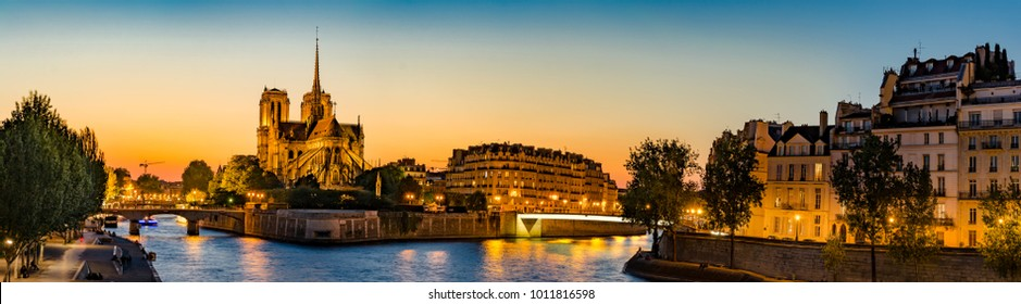 Notre Dame de Paris, France, panoramic view of Seine river at sunset