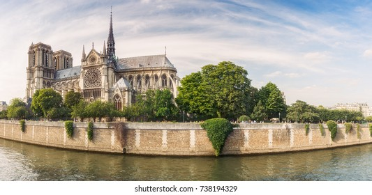 Notre Dame de Paris, France, at daytime. Panoramic travel background. Scenic cityscape with dramatic sky.