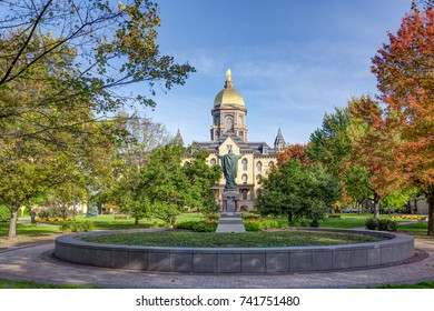 NOTRE DAME, IN/USA - OCTOBER 19, 2017:  Jesus Statue and Golden Dome on the campus of Notre Dame University.