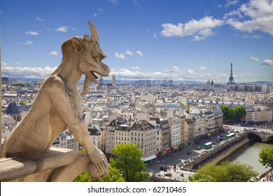 Notre Dame of Paris: Famous Chimera (demon) overlooking the Eiffel Tower at a summer day