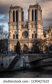 Notre Dame, Paris France - January 2014: Notre Dame cathedral seen from the river Seine on a late winter afternoon