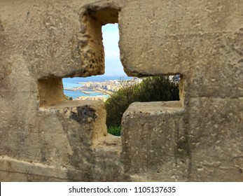 Notre-Dame d'Afrique Basilica, Algiers, Algeria - March 30, 2018: Watching the city through the holy cross shape in the garden of the basilica.