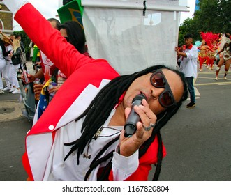 Notting Hill,London/UK 08-27-18 The Notting Hill Carnival 2018. One of the energetic singers with Paraiso school of Samba, one of the many samba bands at the event.