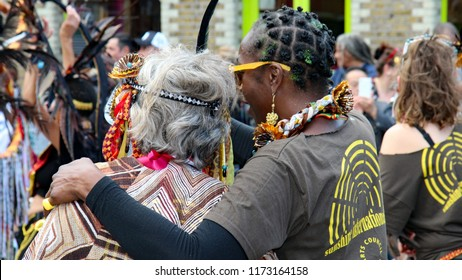 Notting Hill,London/UK 08-27-18  Notting Hill Carnival 2018 . A display of love and friendship at the canival as one participant puts an arm around another