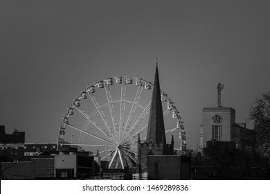 Nottingham City Centre, England, UK. February 23, 2019 Nottingham skyline with the observation wheel and church spire. Black and white cityscape photograph of Nottingham