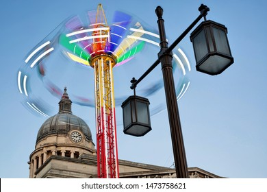 Nottingham City Centre, England, UK. July 24, 2018 Amusement park ride in motion in front of Nottingham council house building, old market square, Nottingham, UK