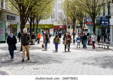 NOTTINGHAM, ENGLAND - APRIL 12: Sunday shoppers enjoying a sunny spring day on Albert Street. Costa and Marks & Spencer in background. On 12th April, 2015, in Nottingham, England.