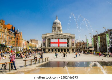 Nottingham, England April 21 2015. City square showing England flag with clear blue sky.