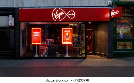 NOTTINGHAM, ENGLAND - AUGUST 30: Frontage of the Virgin Media store at night on Clumber Street. In Nottingham, England. On 30th August 2016.