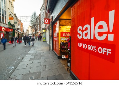 NOTTINGHAM, ENGLAND - DECEMBER 26: Big red Boxing Day sales poster and shoppers on Clumber Street in Nottingham. In Nottingham, England. On 26th December 2016.