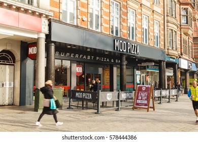 NOTTINGHAM, ENGLAND - FEBRUARY 13: People walk past MOD Pizza restaurant in Nottingham. In Nottingham, England. On 13th February 2017.