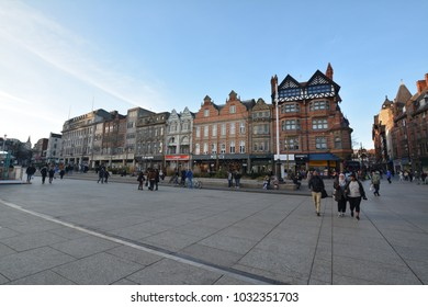 Nottingham, England - February 24, 2018: Tourists shopping at the Shops on Old Market Square with the Council House during spring.
