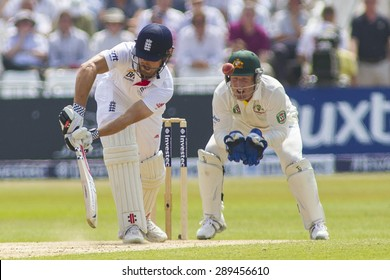 NOTTINGHAM, ENGLAND - July 12, 2013: England's Alastair Cook hits the ball and is caught out at slip by Michael Clarke during day three of the first Ashes Test match at Trent Bridge Cricket Ground