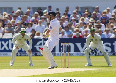 NOTTINGHAM, ENGLAND - July 13, 2013: Mitchell Starc bowls the first ball of the day wide as Michael Clarke, Ian Bell, and Brad Haddin look on at the Ashes Test match at Trent Bridge Cricket Ground