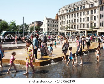 Nottingham, England, July 29th 2019 People from all walks of life take time to cool off in the fountains in the Old Market Square, Nottingham during a heat wave