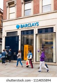 NOTTINGHAM, ENGLAND - JUNE 16: Shoppers walk past a Barclays Bank which has an Amazon locker for parcel pick ups, in Nottingham, England. In Nottingham, England. On 16th June 2018.
