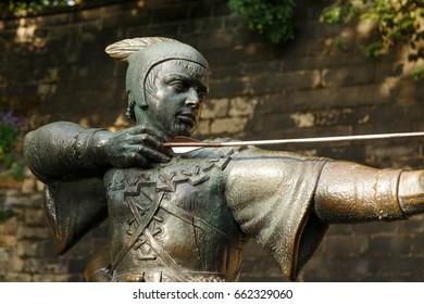 NOTTINGHAM, ENGLAND - JUNE 17: Close up of statue of Robin Hood, near Nottingham Castle. In Nottingham, England. On 17th June 2017.