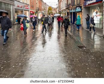 NOTTINGHAM, ENGLAND - NOVEMBER 21: Lots of people walking in rain past shops on Clumber Street in Nottingham. In Nottingham, England. On 21st November 2016.