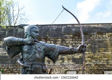 Nottingham, England, UK. April 06th 2019. The iconic Robin Hood statue stands outside Nottingham castle. Vandals damage arrow of bronze figure.