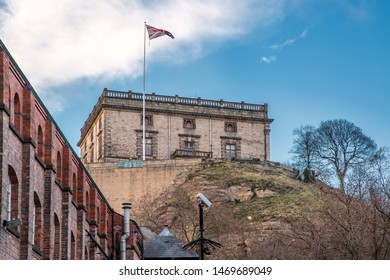 Nottingham, England, UK. February 11, 2018. Nottingham Castle from the banks of the Nottingham Canal. The Castle is set in a bright blue sky with white cloud, and includes the Union Jack at full mast.