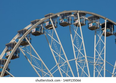 Nottingham, England, UK. February 17, 2019 Nottingham observation wheel in front of a clear blue sky Located in Nottingham Old Market Square
